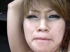 Naughty Japanese wench in fishnet stockings gets toy fucked