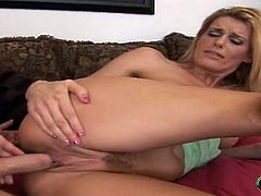 Have a good time watching this blonde cougar, with natural breasts wearing pink panties, while she gets nailed hard and moans like a slut!