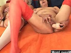 These two cute grannies have a blast together by licking each others hairy cunts. They also play with vibrators. They shove them in her pussies and masturbate next to each other.