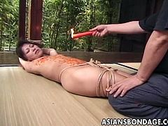 This sadistic master has something painful in store for his Japanese slave. He ties her up and starts pouring hot wax all over her body, including on her tongue.