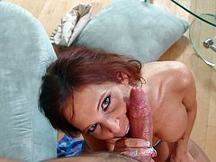 Take a look at this hot scene where the horny redhead milf Syren De Mer sucks on this guy's big cock until he cums in her mouth.