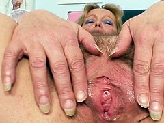 Dirty mature nurse shows off her juicy twat in a nasty solo action