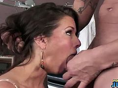 Veronica Avluv is a hot milf with huge tits. She gobbles on this guy's cock before getting on her knees with her ass up in the air, preparing for a deep pussy slamming.