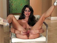Karina White with big boobs and hairless cunt getting naked for you to enjoy in solo scene