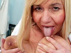 This nasty mature nurse shows off in lusty session of rough solo masturbation