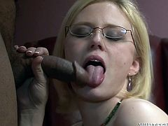 Get a load of this interracial scene where Clayra Beau ends up with her ass covered by cum after sucking and biting this guy's big black cock.