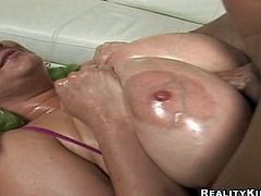 Huge tittied MILF gets oiled up and then fucked rough