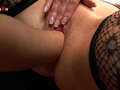 Two busty bitches oils up each other's huge natural boobs and one of them fingers other in steamy Filthy and Fisting lesbian sex video!