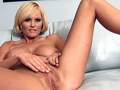 Insolent Hannah Hilton likes to pose when stretching and fingering her warm cunt