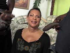 She is such a candy milf with two huge tits. So, this slutty milf will be enjoying her time on that pair of huge black cocks!