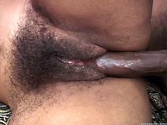 Desire is a horny ebony babe having her hairy pussy drilled by this guy's hard cock in this great scene I'm sure you'll like.