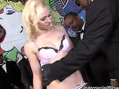 Entertain yourself by watching this blonde babe, with natural tits wearing sexy lingerie, while she gets gangbanged by big black cocks.