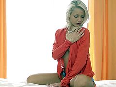 Have fun with this amazing solo scene where the gorgeous blonde Grace has an orgasm as she fingers herself and masturbates with a dildo.
