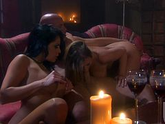 Two brunettes and a blonde suck a huge dick in a dark room. These beauties take hard and deep pussy pounding. Such hot babes deserve to be fucked well.
