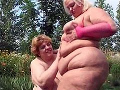 Two BBW ladies masturbating in outdoor scene is quite a show