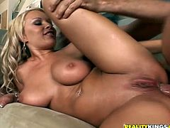 Gorgeous blonde Jessica Moore kneels in front of some guy and pleases him with a blowjob and a titjob. Then she stands on all fours and lets him drill her shaved pussy doggy style.