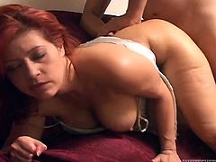 Busty redhead milf Misty Mendez is doing all what she can to satisfy Johnny Fender. She sucks his massive cock and rubs it against her awesome tits and then they bang in cowgirl and other positions.