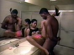 Tall and beautiful black girl is getting screwed missionary style in the bathroom. She then bends over the sink getting hammered hard doggy style.