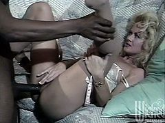 White wife Britt needs that black cock. She lets him bend her over the couch and drill her with that black cock while her friend watches.