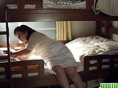 Filthy Japanese MILF masturbates in her son's bedroom. She imagines some young cock fucking her. She surely is craving for some tasty cum explosion inside her.