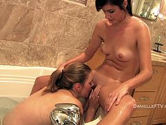 Two horny babes take a bubble bath together. These sexy lesbians kiss and also lick each others wet pussies right in the bathtub.