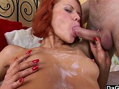 She squirts lotion all over body and rubs it in while sucking this guy's cock then she rolls onto her side and surrenders that tight ass.