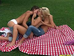 Take a nice look at these lesbian babes, with big tits wearing jeans, while they lick each other's pussies outdoors as if they were lollipops.