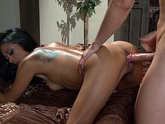 Captivating tattooed Kaylani Lei is having fun with some guy indoors. She sucks and rubs his weiner and then takes it in her Asian cunt and gets it stunningly fucked.