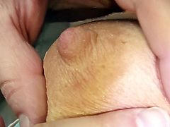 Feeling warm hands stretching her hairy twat makes mature quite horny