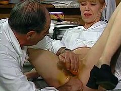 Light haired lusty chick posed in missionary style on table. Her dirty minded old freak employed huge cucumber to satisfy her hot pussy and big carrot to tickle her dumpy asshole. Look at this kinky guys in The Classic Porn sex video!