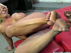 These two strip down and have some fun on the floor as she uses her feet to jerk his throbbing black cock until he drops a load all over her.