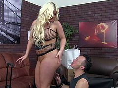 Julie Cash is a curvaceous blonde domina with big tits and bubble ass. Hot woman in black fishnet outfit smothers man with her huge buttocks. She loves facesitting and smothering so much!