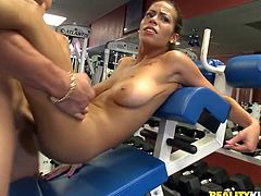 Get excited watching this brunette, with big boobs wearing sportive clothed, while she exercise at the gym and gets drilled hard too.