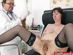 Mature brunette strips off her clothes at the medical examination. She sits down on a gynecological chair. A doctors examines her hairy pussy and lets her go.