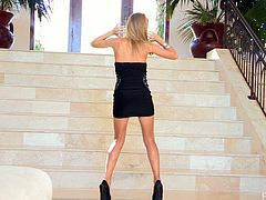 Naughty Lauren poses for the camera in her black dress and high heels. Then this girl strips her clothes off. She masturbates lying on a sofa and also twists a hoop.