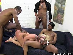 Take a look at this hardcore gangbang scene where the slutty blonde Leya Falcon is nailed by threesome black monster cocks in front of the camera.
