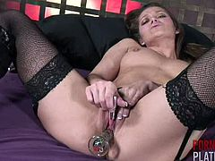 Dani Daniels has a pink lipstick in her hand and a big vibrator inside her pussy. She wants to color her lips, but she can't because that's a vibrating lipstick.