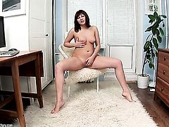 Redhead fills the hole between her legs with dildo for cam in solo action