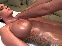 Alison Tyler is a business lady that needs massage badly after three hour long conference. She gets nude with no shame and masseur Keiran Lee puts his hands on her huge melons and trimmed pussy with enthusiasm.
