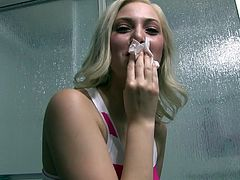 Jenna Ivory finishes her interracial scene then she goes backstage and wipes the cum off her face before getting in the shower.