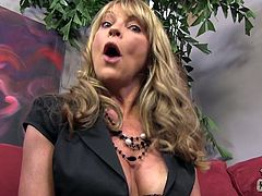 Have fun watching this blonde cougar, with giant knockers wearing nylon stockings, while she uses her hands wisely in a backstage video.