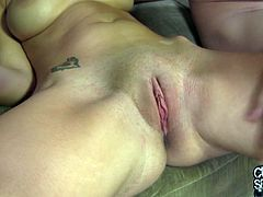 Mae was relaxing on the couch naked when her man reached over and started rubbing, teasing, and spreading her pussy wide open.