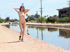 Sexy Bethany fondles her hot pussy and boobs in a public place. But she goes even further. This redhead chick strips off her clothes and walks in the street.