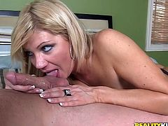 Press play to watch this blonde cougar, with giant boobs wearing leather clothes, while she gets fucked hard over a nice bed by a nasty dude.