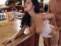 Famous porn actress seduces sexy guy for hardcore sex in the kitchen. Busty mom bends over the kitchen counter getting banged doggy style.