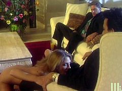 Gorgeous blonde milf Roxanne Hall is getting naughty with a few dudes indoors. She sucks and rubs their cocks and then gets her face and tits covered with cum.