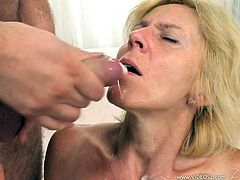 Have fun with this hardcore scene where a mature blonde gets a facial after having a threesome with two guys.