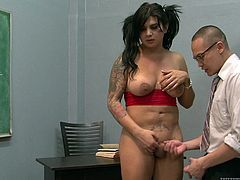 Watch the horny shemale Stephanie Tricks end up with her tits covered by cum after drilling this guy in a class room.