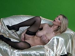 Carol Gold is ready to make you day as you watch this hot blonde Carol Gold playing with her wet pussy.