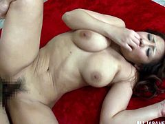 Double penetration in a Japanese way with a horny Asian milf! She sucks both of them and one remains in her mouth, while the other one goes for her twat